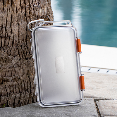 SMOOTH TRIP<sup>&reg;</sup> SplashSafe™ Storage Box - This clear impact and water-resistant case protects daily essentials from spills and splashes.  Features rubber seal gasket with dual clamp closure and the ability to hang from belt loop, tote, or pack with attached carabiner.  Measures: 7.25&quot; x 4.25&quot; x 1&quot;.