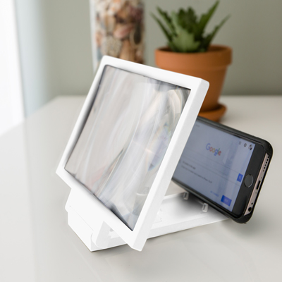 "SUNTONE™ Mobile Phone Video Magnifier - Increase the size of your mobile phone viewing with this video magnifier.  Fold out screen measures 8.2""."